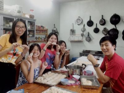 Daniel's class wrapping dumplings for Chinese New Year